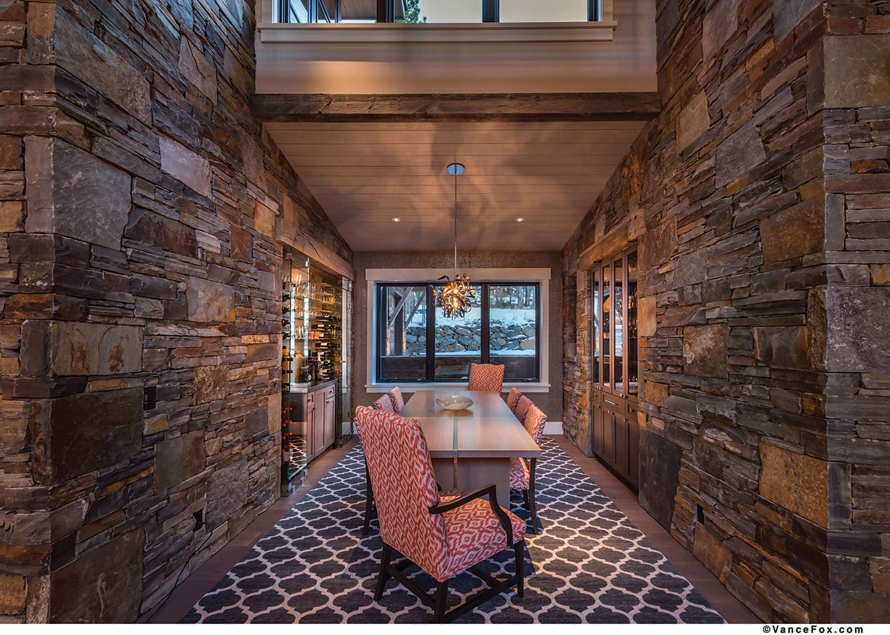 The Custom Dining Table Is Oak With A Stripe Of Stainless Steel Running Through Middle Graffiti Light Fixture By Corbett Lighting Hangs Above